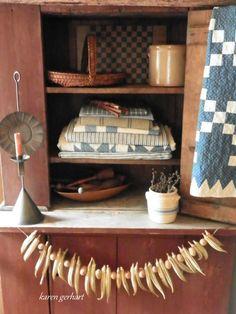 Prim cupboard, textiles, and smalls
