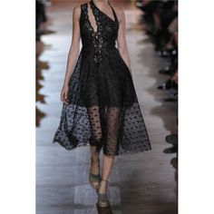 Stella McCartney's Caroline lace dress is the perfect blend of sweet and sultry.   A slash here and a sheer panel there suggests at the subtlest hint of skin beneath.  Lace.  Asymmetric str...