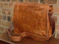 Simple. Cognac leather messenger bag.
