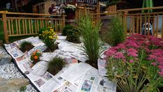 Plant your plants in the ground, work the nutrients in your soil. Then wet newspapers, put layers around the plants overlapping as you go, cover with mulch, and forget about weeds. Weeds will get through some gardening plastic they will not get through wet newspapers.