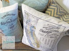 How to make vintage map pillows, using premade pillow covers and iron on transfer paper.