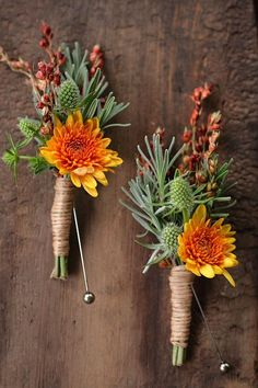 October boutonnieres.  This designer is so, so good.