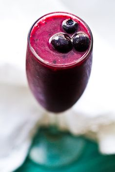 Spiced Blackcurrant Blitz Smoothie  vegan, makes 2 servings    1 cup blackcurrant juice (I found some at Whole Foods)  1 cup frozen blueberries  1/2 cup ice cubes (or coconut water ice cubes, my fave)  1/2 cup plain or vanilla soy yogurt  1/2 tsp apple cider vinegar  2-3 dashes of cayenne  1/4 tsp vanilla extract  garnish: thawed frozen blueberries    optional: 1/2 cup frozen blackberries (add a tad more juice to compensate)  optional: 1 frozen banana for a thicker, less-sweet/tart flavor)…