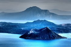 Anthony: I like the look of a volcano partly or fully surrounded by water, also the comparison of the volcano to the mountain behind it shows quite a difference Philippines, Taal Volcano, The Dark One, World Travel Guide, Shades Of Blue, The Great Outdoors, Cool Photos, Amazing Photos, Places To Go