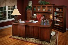 Amish Montgomery Office Suite This exquisite office suite is made with solid wood. Includes one executive desk, one credenza desk, hutch, file cabinet and bookshelf. American made in the wood and stain you choose. #officesets #officefurniture