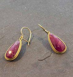 "Bask+Ruby+Teardrop+Earrings+-+18K+gold+and+faceted+ruby+(16.5+TCW)+teardrop+earrings+on+hook+wires,+approximately+1+1/2""+in+length."
