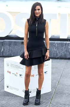 Jennifer Connelly in a ruffle black mini dress and booties
