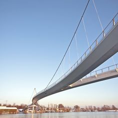 Wilkinson Eyre Architects' Nescio Bridge is a curved suspension bridge in Amsterdam that forks at either end to separate pedestrians from cyclists