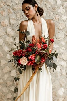 Moody and autumnal tropical-inspired bridal bouquet | Image by Lily Red Creative