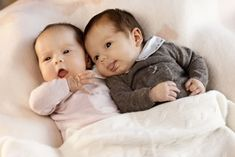 Crown Princess Mary and Crown Prince Frederik show off their baby twins at Amalienborg Palace in Copenhagen.