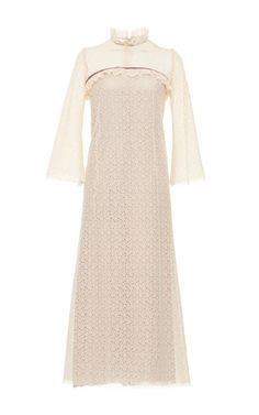 This **Luisa Beccaria** dress features a high collar, ruffles at the neck and yoke, and three quarter sleeves.