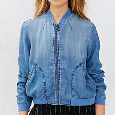 Denim bomber The softest bomber jacket from BDG. Chambray construction cut at the waist with a ribbed-banded hemline and ribbed-banded rounded collar and cuffs finished with a zippered placket and snap-button pouch pockets. 100% lyocell and machine washable! Urban Outfitters Jackets & Coats