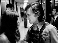 Barbi Benton, left, former Playboy Playmate and now a member of the Hee Haw cast, talks with her boyfriend Hugh Hefner backstage before the camera starts rolling in the Hee Haw tapings Oct. 17, 1973.