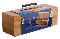 This Art Studio Bamboo Storage Box is exclusive to WHSmith. A stylish and practical solution for storing and carrying your art materials.Made from exquisite Bamboo material with a double hinged lid, a leather strap handle and two front clips.Inside the box there is one main compartment with a central divide which can be removed if you wish and a long narrow tray that can sit on top of the dividers.