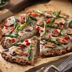 Cauliflower Crust Pizza with Garlic Coconut Cream Sauce - a gluten-free cauliflower crust that is actually vegan, too!