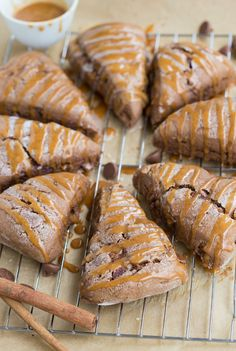 These chocolate pumpkin scones have all the great flavors you know and love from pumpkin chocolate-chip cookies. PLUS there are chocolate chips in them and a delicious cinnamon-spice pumpkin glaze covering them! Pumpkin Scones, Pumpkin Spice, Cinnamon Spice, Just Desserts, Dessert Recipes, Scone Recipes, Desserts Diy, Flour Recipes, Bread Recipes