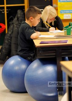 Story: Madison County second-graders sit on big rubber balls instead of plastic chairs