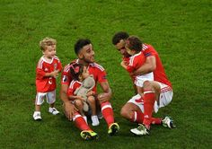 Neil Taylor and Hal Robson-Kanu celebrate their team's 3-1 win with their children