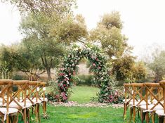 Outdoor wedding ceremony - greenery and red flower arch for wedding ceremony- Find an event planner on WeddingWire! {ALL ABOUT EVENTS}