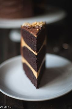 Chocolate cake with salted caramel buttercream and honeycomb pieces, covered in dark chocolate ganache.