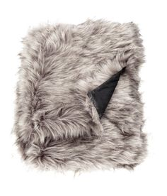 Check this out! Throw in faux fur with woven cotton fabric at back. - Visit hm.com to see more.