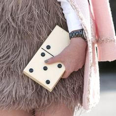 The editors at #Tastevin love how the cheeky quality of the clutch plays into the quirky feathered skirt.