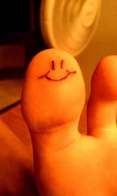 toe tattoo. smiley face.
