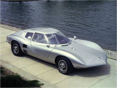 1962 Chevrolet Corvair Monza GT Concept was one of the highlights of the 1962 New York Auto Show. The Corvair Monza GT featured a fiberglass body, a large Plexiglass windshield, and an air-cooled 6-cylinder engine placed ahead of the rear axle.