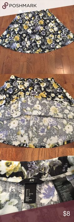 """Floral Skirt Cute skater skirt from h&m. It's super nice and soft, only worn a few times. I'm about 5'7"""" and it goes halfway down my thigh when I pull it past my waist. Make an offer H&M Skirts Circle & Skater"""