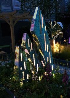 The Eveque at the Chelsea Flower Show, illuminated at night from its window voids