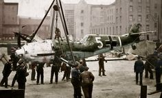 Cleaning the remains of a shot-down German Messerschmidt fighter in Italy.