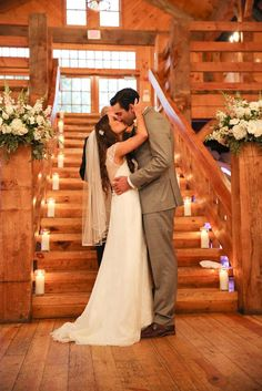 The first kiss as Mr. & Mrs. at this beautiful Rustic Chic Wedding.