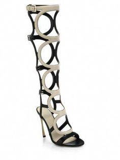 b04a2b3af897 More ideas. Sergio Rossi Arabe Knee-High Leather Gladiator Sandals ...