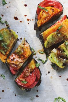 Roasted basil eggplant topped with fresh heirloom tomatoes and balsamic vinegar. This vegan, and gluten-free dish is great as a summer main or easy summer appetizer. Veggie Dishes, Vegetable Recipes, Vegetarian Recipes, Healthy Recipes, Healthy Snacks, Veggie Food, Think Food, I Love Food, Whole Food Recipes