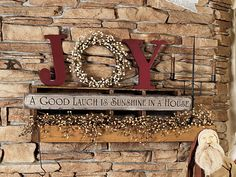 """Paint wood letters red and use them to flank a round wreath to add a little """"joy"""" to a shelf display. To see more of this room, turn to page 94 in our January 2014 issue: http://www.countrysampler.com/issues/detail.php?issue_code=C0114"""