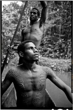 Papua New Guinea | Men who have been initiated into the Crocodile Clan.  Sepik River region. |  ©David Kirkland