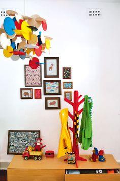 Bright Normann Copenhagen 'Bau' pendant lights hang above colourful hand-me downs. #kids #bedrooms #colour