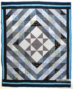 Star in the Center Blue and Whites Quilt - PageQuilts.com - Feel the Warmth Under A Quilt