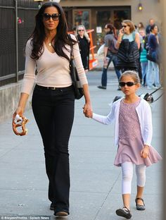 Pret-ty tasty: Padma Lakshmi tucked into a giant pretzel as she went walkabout with daughter Krishna in New York on Wednesday Padma Lakshmi, Walkabout, Celebs, Celebrities, Bliss, Capri Pants, Daughter, Nyc, Celebrity
