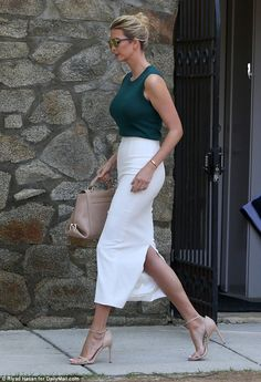 Added touches: Ivanka's white pencil skirt featured a large slit in the back ... What Ivanka Trump is wearing today August 1 2017. Dark green top, white skirt with back slit, taupe purse and heels.
