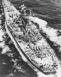 Aerial view of US battleship Massachusetts, 1943; note OS2U Kingfisher float planes on the fantail catapults