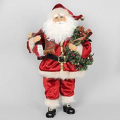The Party Gifts Santa from Karen Didion Originals brings the joy of Christmas into your home. The quality of this figurine is unmatched with its hand-painted face, glass inset eyes, real mohair beard, unique fabric, and detailed accessories.