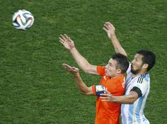 Robin van Persie of the Netherlands fights for the ball against Argentina's Ezequiel Garay during their 2014 World Cup semi-finals at the Corinthians . Robin Van, Van Persie, World Cup 2014, Semi Final, Finals, Netherlands, People, Argentina, The Nederlands