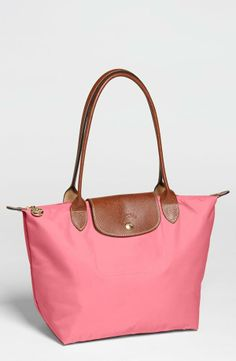 Love this classic Longchamp Tote in Pink!! I would tote this around all day everyday !