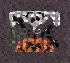 Pumpkin Ghost Block by San Man Designs I loved stitching this. It's on Monaco fabric that I dyed. I used Dmc glow-in-the-dark floss for the...