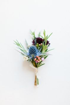 Thistle And Flower Fresh Spring Buttonhole Pinned By High Billinghurst Farm Wedding Venue