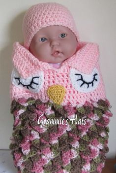 This sale is for the baby owl cocoon and cap set. Newborn sized.  The sleepy eyed cocoon is a pink and camo pink sack made in the crocodile stitch.