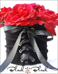 "Corset vase covers- What an easy way to cover an old ugly coffee can or recycled ""holder"" for centerpieces."