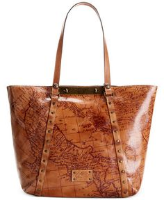 This Patricia Nash bag takes a modern shape and pairs it with antique detailing for a nostalgic, well-traveled appeal. Aged gold-tone hardware and antique images decorate this unique design.   Leather