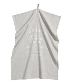 Tea towel in a linen and cotton blend with a printed text design. Hanger loop on one short side. Size 20 x 28 in.